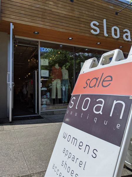 PMG PHOTO: JOSEPH GALLIVAN - Sloan Boutique on Northwest 23rd Avenue reponened on Friday, May 15.