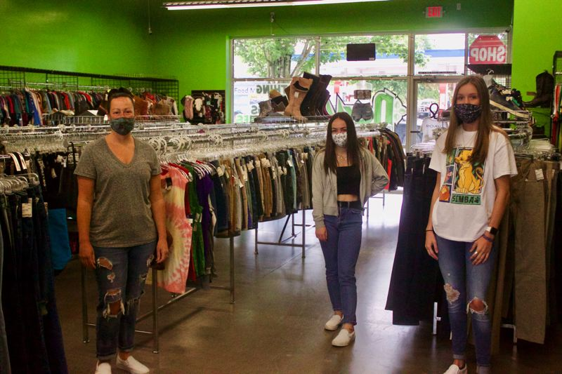 PMG PHOTO: CHRISTOPHER KEIZUR - Jana Volk (left), owner of Nexxt, the Gresham resale clothing shop, opened Friday morning, May 15, and she and her employees are ready for customers.