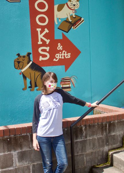 PMG PHOTO: CHRISTOPHER KEIZUR - Alyse Wecker is masked up and ready to deliver orders curbside at Maggie Mae's Kids Bookshop. The bookstore, which also carries adult titles, is not expecting to open for browsing until next month.