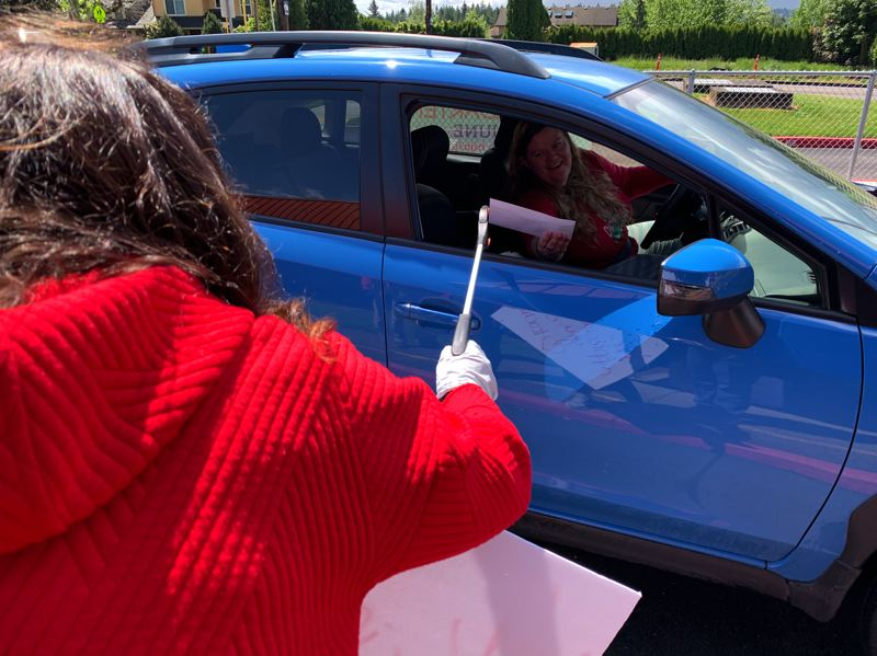 COURTESY PHOTO: GRESHAM-BARLOW SCHOOL DISTRICT  - A teacher stops by Powell Valley Elementary School to pick up her gift card. Social-distancing was de rigueur.