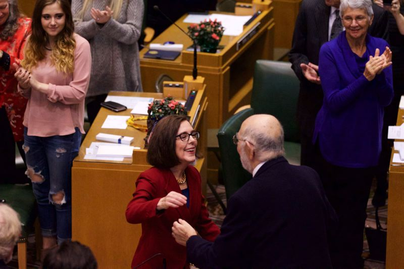 PMG FILE PHOTO - Gov. Kate Brown embraces Rep. Mitch Greenlick (D-Portland) during her inauguration at the State Capital.