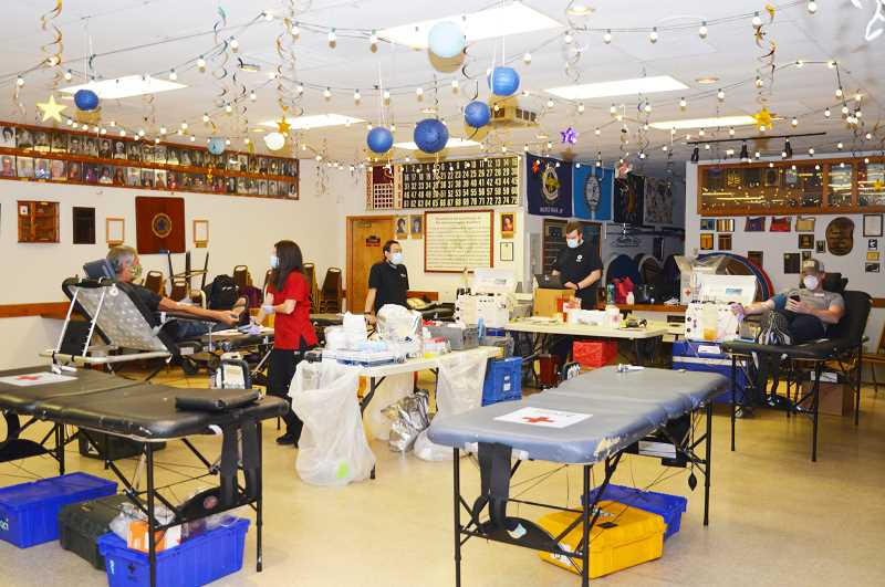 COURTESY PHOTO - Tables are spaced apart for social distancing as people donate blood at the American Legion post in Milwaukie.