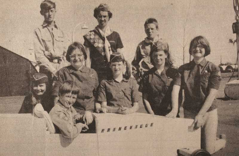 CENTRAL OREGONIAN - May 21, 1970 – Admiring the Prineville Racer, driven by Jim Jordan, are, kneeling, left to right: Kathy Schlichting, Susan Gilbertson, Susie and Kathy Vliet and Shirley Gilbertson. Standing behind are Louis Jordan, Mrs. Hoffman and Don Vliet, all members of the Pathfinders group from the Prineville Adventist Church, which attended a Pathfinder Fair for SDA Youth in Salem.