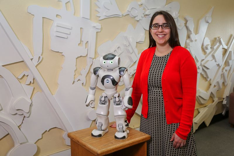 COURTESY PHOTO: OSU COLLEGE OF ENGINEERING - Naomi Fitter, Oregon State University assistant professor of robotics, used Jon the Robot comedian to find out how robots and humans could better interact through humor.