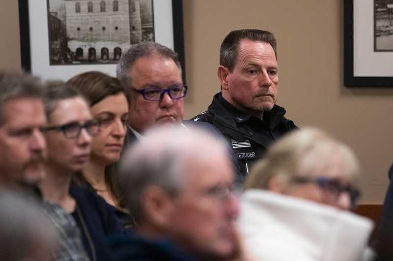 PMG FILE PHOTO - West Linn Police Chief Terry Kruger listens to public testimony calling for his firing during a special session of the City Council addressing a racially-charged false arrest in 2017.