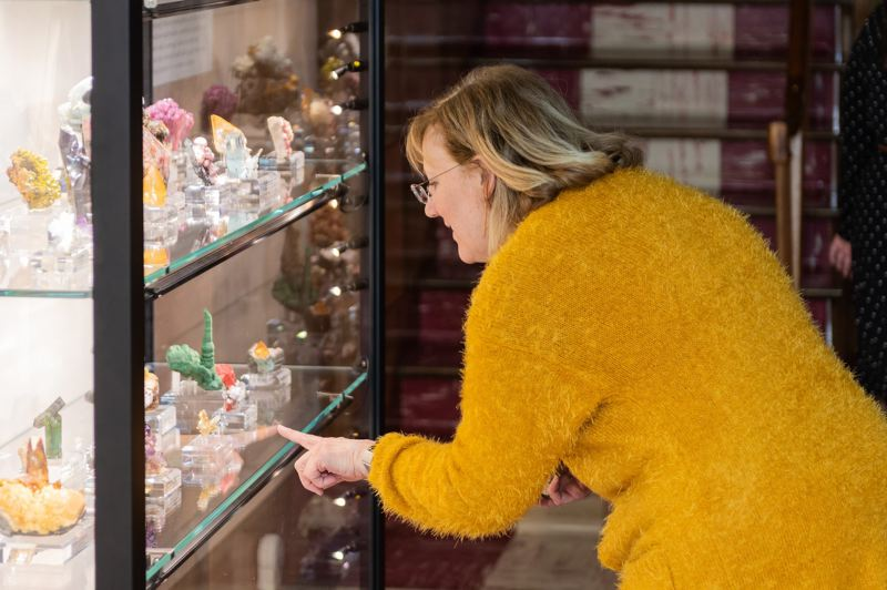 PMG FILE PHOTO: - A visitor at the Rice Museum of Rocks & Minerals in Hillsboro observes a collection before the coronavirus pandemic.