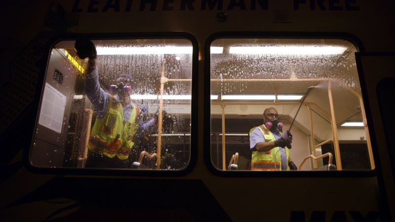 COURTESY PHOTO: TRIMET - TriMet staff disinfect a MAX train car in the transit agency's fight against COVID-19.