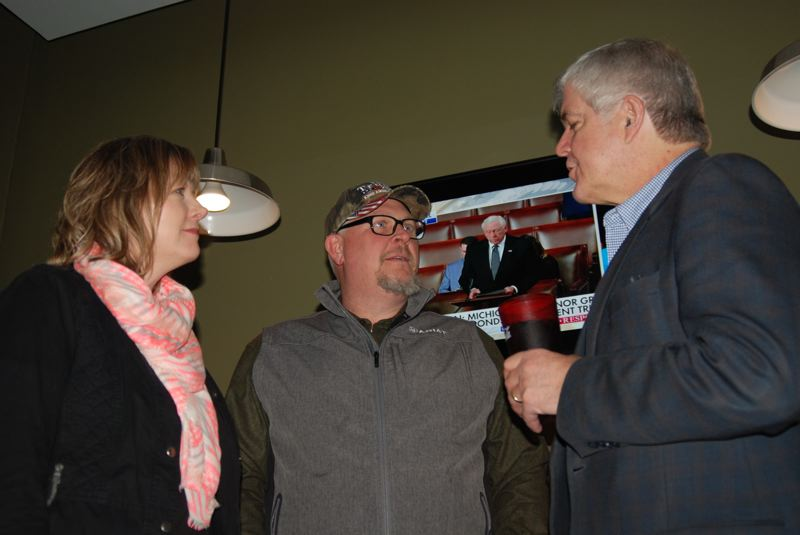 TERESA JACKSON/MADRAS PIONEER - Laura and Lyle Rehwinkel talk with Cliff Bentz, who is running to represent Oregon's 2nd District in the U.S. House of Representatives. The meet and greet was at Madras Brewing Co. on Tuesday, Feb. 7., Madras Pioneer - News Bentz is running for a seat in the U.S. House of Representatives, now held by Greg Walden. Cliff Bentz holds meet and greet in Madras