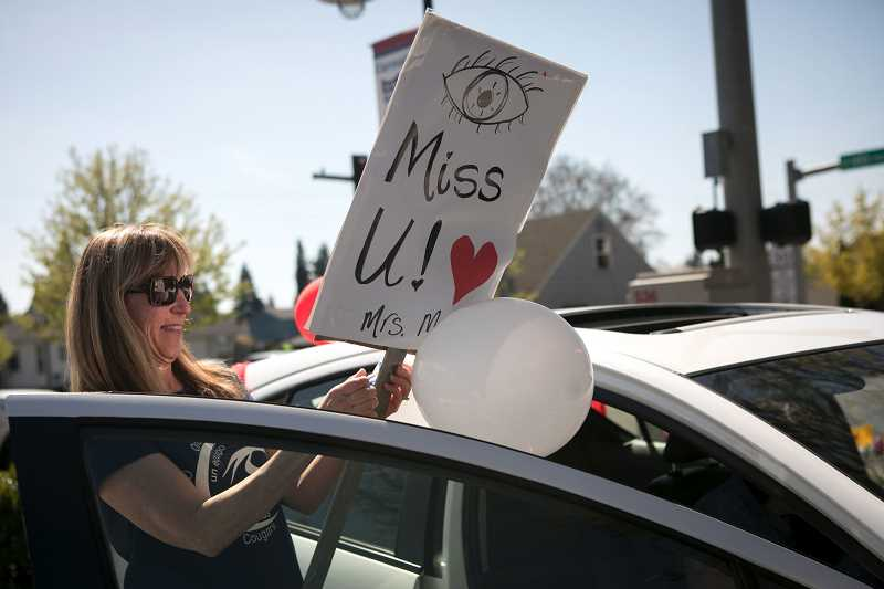 PMG FILE PHOTO - Kathy Murillo, a third grade teacher at Cornelius Elementary School, decorates her car for a teacher and staff parade for students who go to the school.