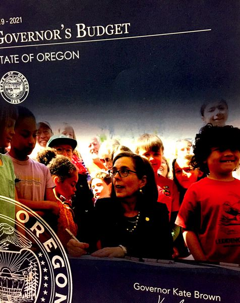 PMG FILE PHOTO - Gov. Kate Brown's 2019-21 budget will face big cuts because of the pandemic shutdown.