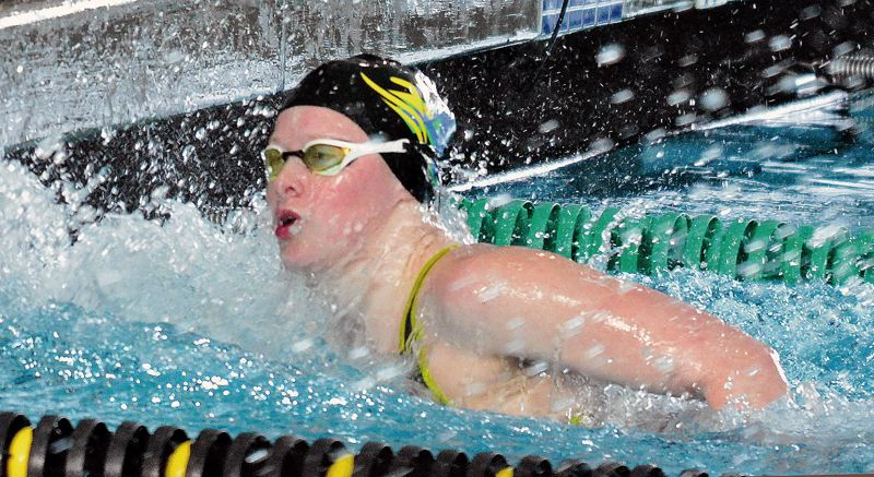 PMG PHOTO: MATT SINGLEDECKER - Aloha senior Kaitlyn Dobler splashes home to win the 50-yard freestyle at the Class 6A state swim meet in February.