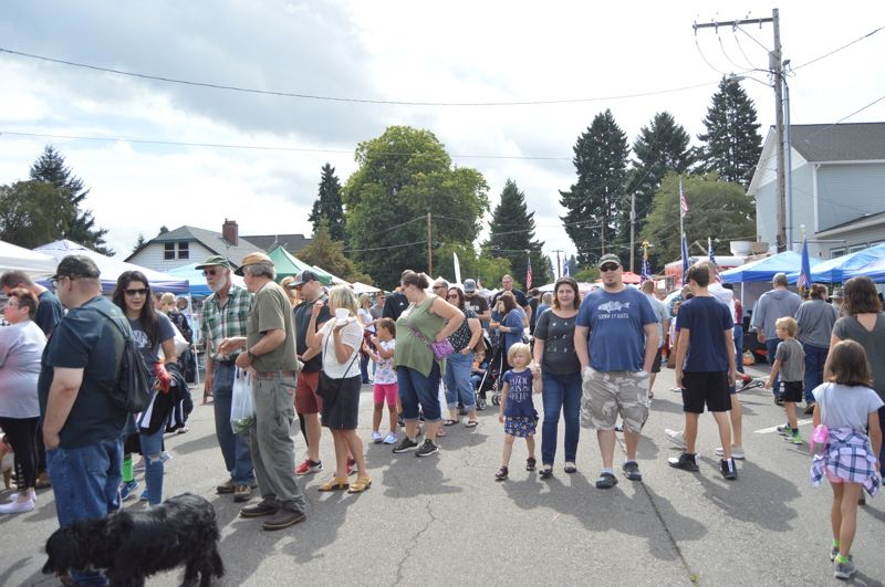 PMG FILE PHOTO - A long line forms for the Famous Scappoose Sandwich being sold by the Scappoose Community Club at last September's Sauerkraut Festival.