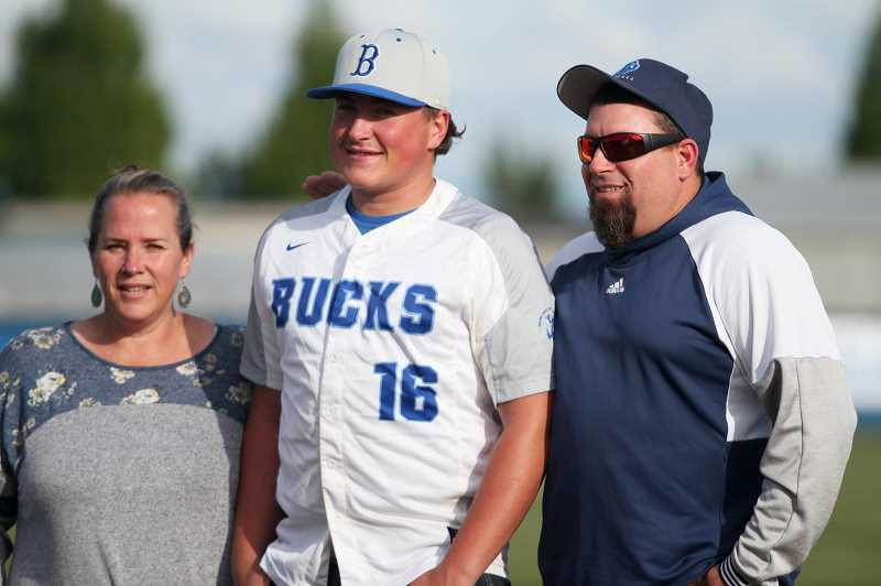 PMG PHOTO: PHIL HAWKINS - Coppola and his family took to the pitchers mound for a family photo on the groomed facilities at Bill Gooding Field. Each St. Paul senior player took turns taking photos on the field before turning in their jersey.