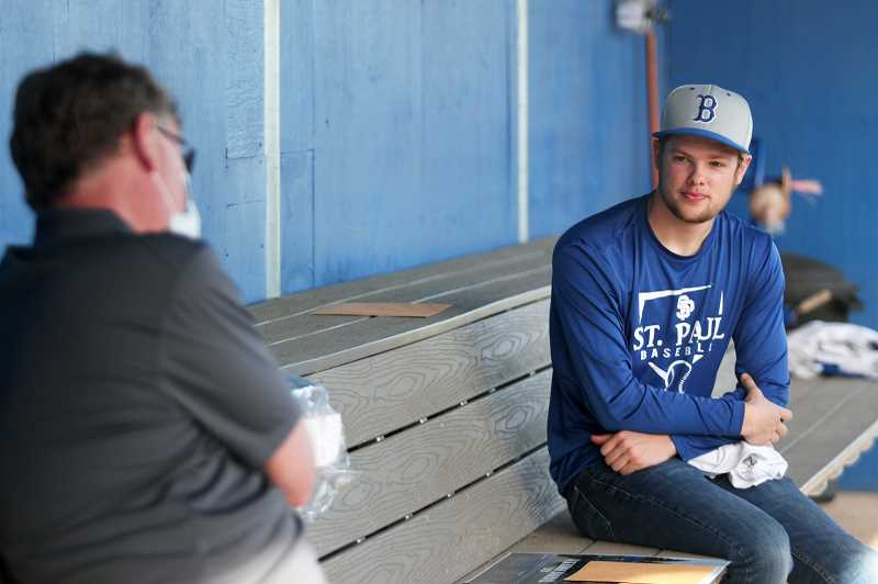 PMG PHOTO: PHIL HAWKINS - Senior Mitch Curtis sits down with Nowlin in the opposing dugout for closing words. Curtis was one of 10 seniors expected to play on this seasons varsity team.
