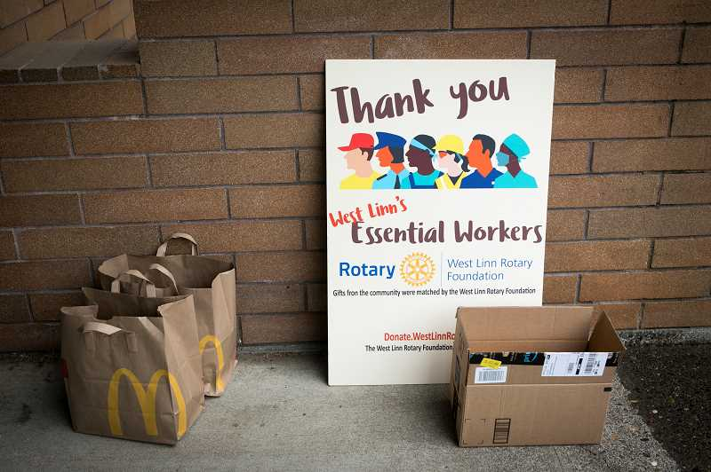MG PHOTO: JAIME VALDEZ - Representatives from the West Linn Rotary Club provided breakfast for workers at the West Linn Post office Tuesday, May 12,  as a thank you to essential workers.