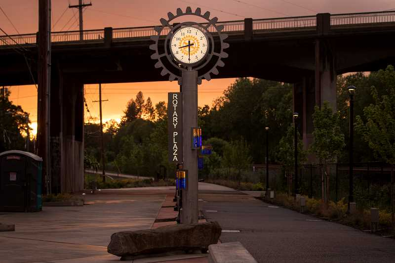 PMG PHOTO: JAIME VALDEZ - The new clock in Tigards Rotary Plaza gleams against the backdrop of a dramatic sunset Monday, May 18. Originally slated to be installed earlier this year, the clock was instead put into place this week due to the coronavirus outbreak.