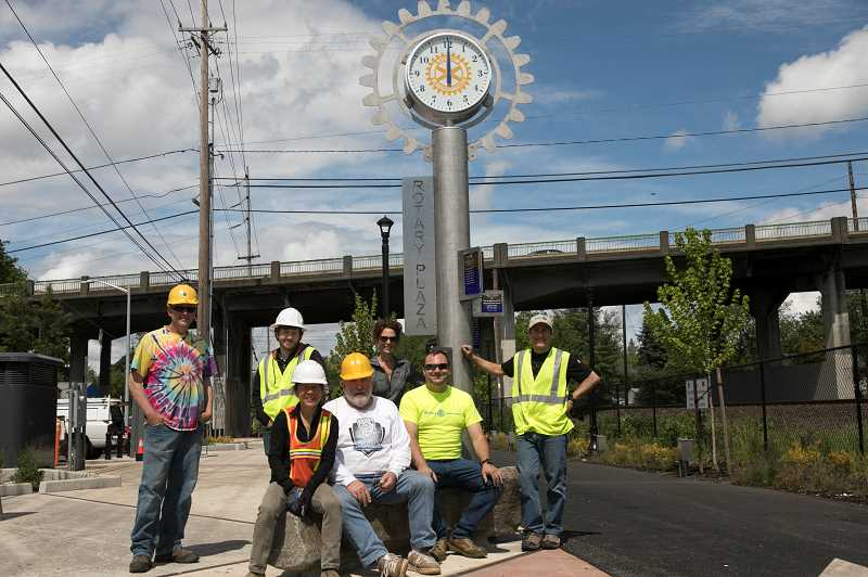 PMG PHOTO: JAIME VALDEZ - The Rotary Plaza clock crew and guests pose after finishing their work on Sunday, May 17. They include, back row: Tony Henderson, left, Gabe Musante, Barb Jones; Front row: Suenn Ho, principal urban designer with RESOLVE Architecture and Planning, Marland Henderson, Brandon Petersen and Robert Musante of Columbia Associates.