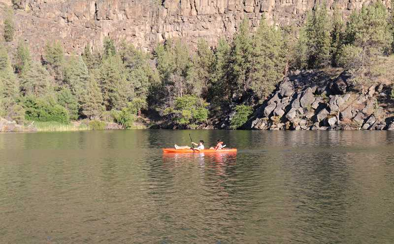 BECKY STEVER/MADRAS PIONEER - Kayakers paddle on Lake Simtustus near Madras. Pelton Park, which is PGE's park on the lake, will open Friday, May 22, in time for Memorial Day weekend.