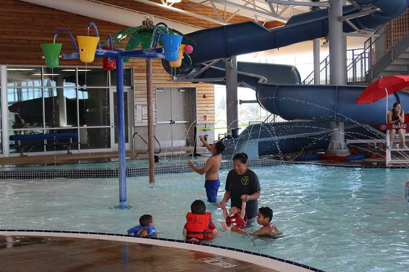 HOLLY M. GILL/MADRAS PIONEER - Children gather near the bucket feature at the Madras Aquatic Center. The district hopes some activities can resume in late June or early July.