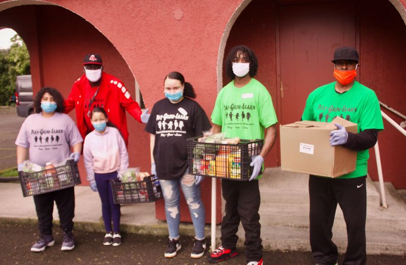 PMG PHOTO: CHRISTOPHER KEIZUR - About 20 volunteers with Play Grow Learn distributed 100 food boxes to families across East Multnomah County.