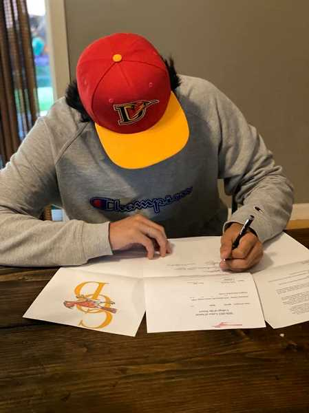COURTESY PHOTO - Sergio Jimenez signs his commitment to the College of the Desert Roadrunners in May.