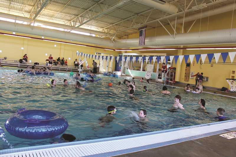 PMG FILE PHOTO: KRISTEN WOHLERS - Swimmers enjoy the newly opened pool in March 2018. Now the pool is closed due to COVID-19, but Director Melissa Georgesen hopes to see it open perhaps in Phase II of Oregon's reopening plan.