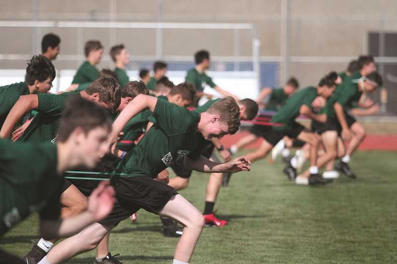 PMG FILE PHOTO: PHIL HAWKINS - Contact sports like football would be prohibited under Phase 1 reopening, but conditioning drills without shared equipment would be allowed, allowing contact sports to meet in a limited capacity.