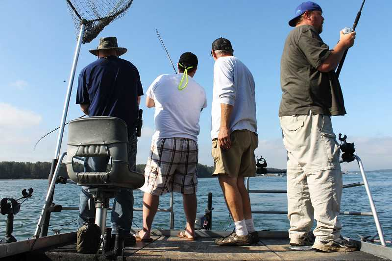 OUTLOOK PHOTO: CARI HACHMANN - Four men fishing for Chinook salmon on the Columbia River near the mouth of the Sandy.