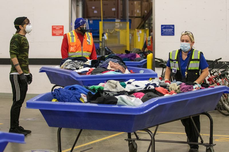 PAMPLIN MEDIA GROUP: JONATHAN HOUSE - Seven more Goodwill stores are reopening. Shoppers at Goodwill Airport on Friday morning,  May 22, 2020, the first time the buy-by-the-pound store had been open in two months. MetaBank cards accepted.