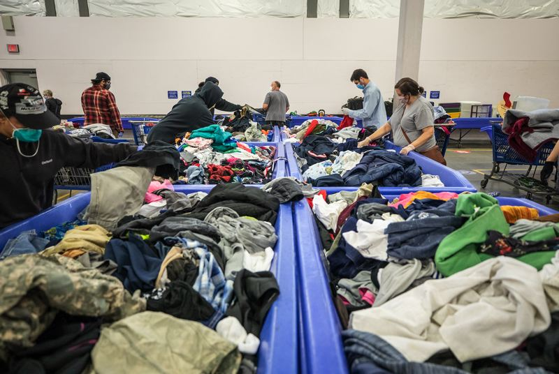PAMPLIN MEDIA GROUP: JONATHAN HOUSE - Seven more Goodwill stores are reopening. Shoppers at Goodwill Airport on Friday morning, the first time the buy-by-the-pound store had been open in two months.