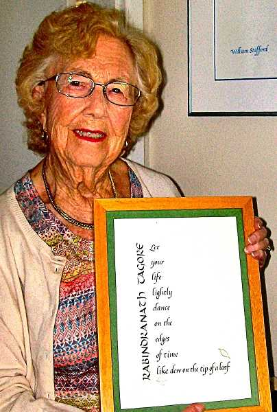 RITA A. LEONARD - Lucille Pierce celebrated her 99th birthday with a parade and a party in mid-May, at her home in the Reed neighborhood. Here, she shares a philosophical thought - expressed in a framed piece of her own calligraphy.
