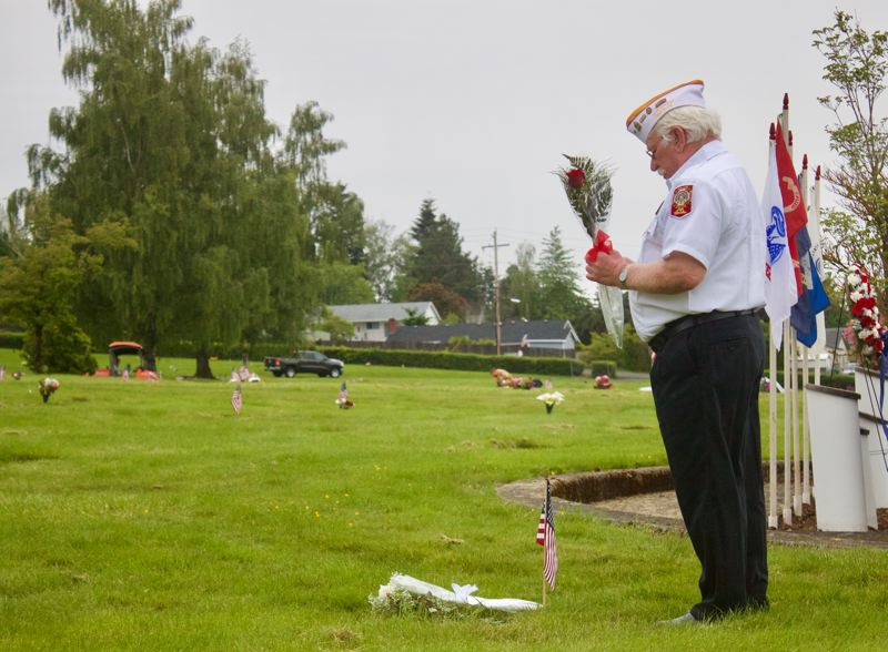 PMG PHOTO: CHRISTOPHER KEIZUR - Gresham Veterans gathered safely Monday morning to honor their fallen comrades.