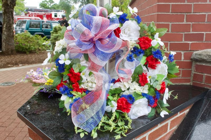 PMG PHOTO: CHRISTOPHER KEIZUR - A wreath was placed at the Gresham Heroes Memorial to honor all of the frontline workers, from nurses to grocery store employees, who are serving during the pandemic.
