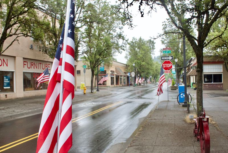 PMG PHOTO: CHRISTOPHER KEIZUR - Veterans placed flags along Main Avenue in downtown Gresham for Memorial Day.