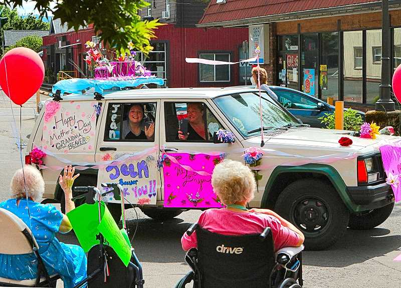 DAVID F. ASHTON - Most of the participating vehicles - like this one, in the Sellwood Mothers Day Car Parade - were brightly decorated and carried greetings to their loved ones residing in Elmcroft Senior Living.