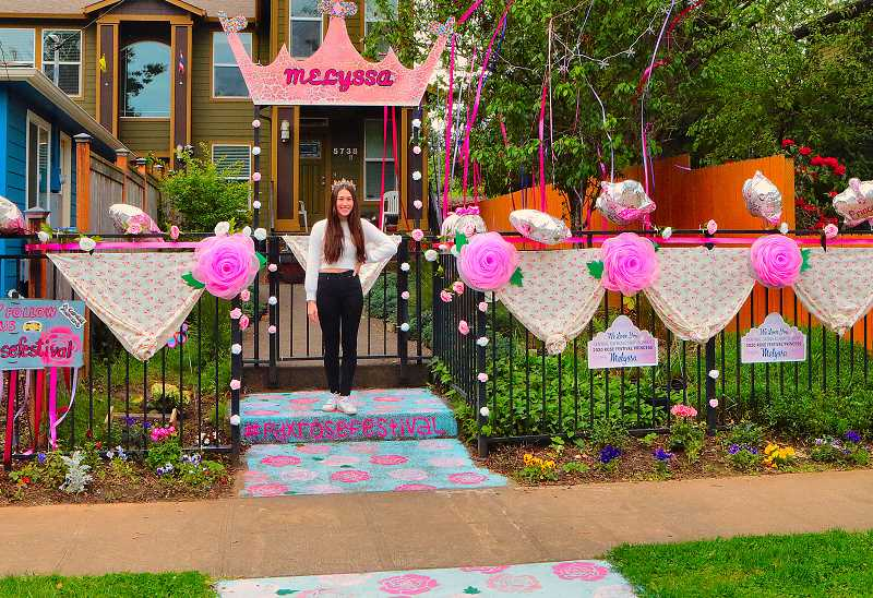 DAVID F. ASHTON - In front of her Woodstock home, which she and her family decorated for this years Porch Parade, was the 2020 Central Catholic High School Portland Rose Festival Princess, Melyssa Okazaki.