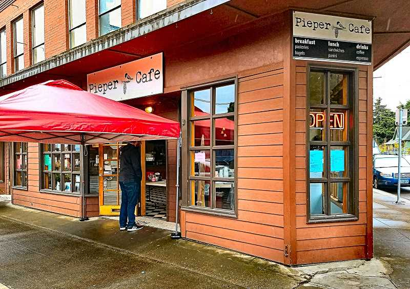 BECKY LUENING - Pieper Café, which had closed its doors in late March, reopened offering sidewalk service on Monday, May 18. The cafe has reorganized, and is now taking orders at the door, rain or shine.