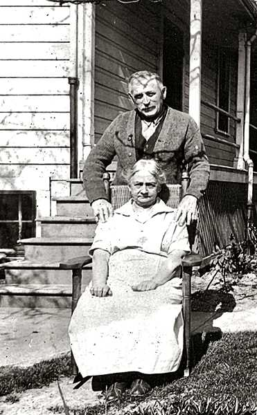 COURTESY OF JOAN & FRED COATES - Ernst and Anna Taggesell, shown behind their Henry Street home in 1927.