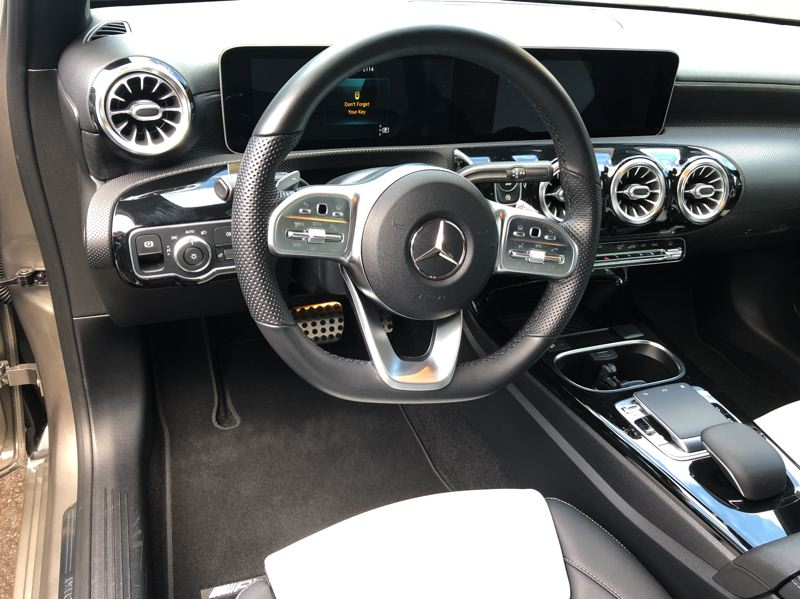 PMG PHOTO: JEFF ZURSCHMEIDE - Inside, the A-Class delivers a true Mercedes-Benz experience. It is a technology powerhouse controlled with a touchpad on the console.