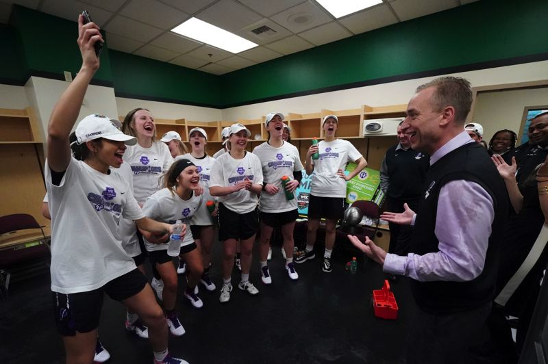 COURTESY PHOTO: KYLE TERADA/UNIVERSITY OF PORTLAND ATHLETICS - Coach Michael Meek and his Pilots are all smiles after winning the WCC tournament.