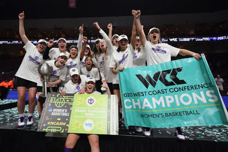 COURTESY PHOTO: KYLE TERADA/UNIVERSITY OF PORTLAND ATHLETICS - The Portland Pilots hold the championship banner after winning the WCC tournament.