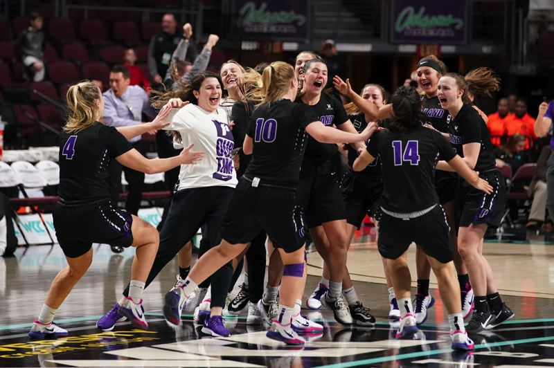 COURTESY PHOTO: KYLE TERADA/UNIVERSITY OF PORTLAND ATHLETICS - It was jubilation for senior Kate Andersen (center) and the Portland Pilots when the horn sounded on their overtime win over San Diego in the WCC championship game.