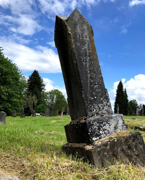 PMG PHOTO: KEVIN HARDEN - A large, tilting monument marking the Yamhill County grave of Nello P. Goodrich is among more than 60 that the Masonic Cemetery wants to repair and reset.