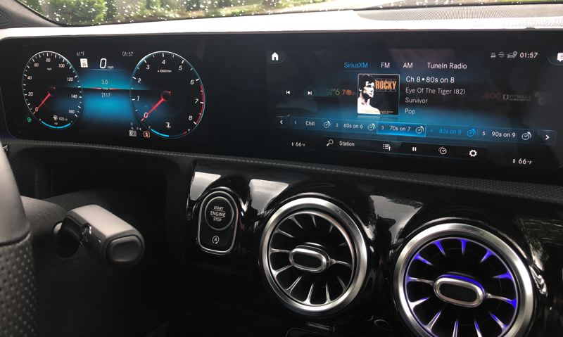 PMG PHOTO: JEFF ZURSCHMEIDE - The 2020 Mercedes-Benz A220 has a single screen stretching across to the center of the dash, with driver information on the left and infotainment and vehicle setting controls to the right.