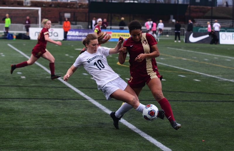 PMG FILE PHOTO - Wilsonville sophomore Lindsey Antonson and Crescent Valley junior Jada Foster battle for possession during the 2019 Class 5A girls soccer championship game.