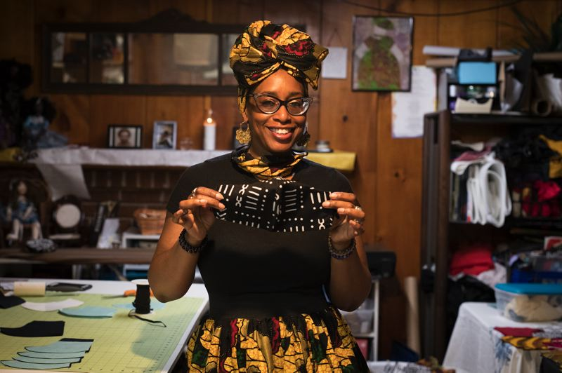 JAIME VALDEZ/PMG - Portland entrepreneur and fashion designer Shalonda Menefee models one of the matching African-print face mask and head wrap combos in her new fashion collection, New Normal 4 Now.