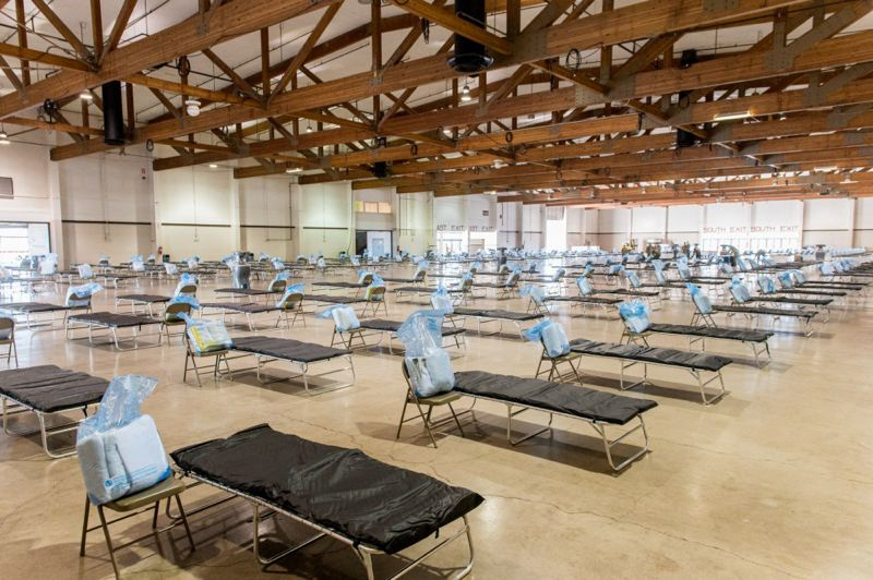 FILE PHOTO - Oregon Army National Guard soldiers set up a temporary 250-bed hospital at the Oregon State Fairgrounds to handle COVID-19 patients and others.