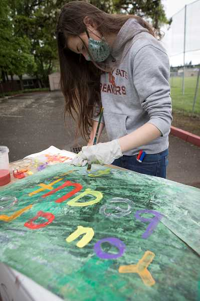PMG PHOTO: JAIME VALDEZ - Sarah, 16, paints the You Are Beautiful on her art panel for the residents at EmpRes Hillsboro Health and Rehabilitation Center in Hillsboro.