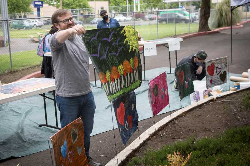 PMG PHOTO: JAIME VALDEZ - Drew Williamson, director of Shelter and Housing of Boys and Girls AID, shows his artwork he painted to the residents at EmpRes Hillsboro Health and Rehabilitation Center in Hillsboro.