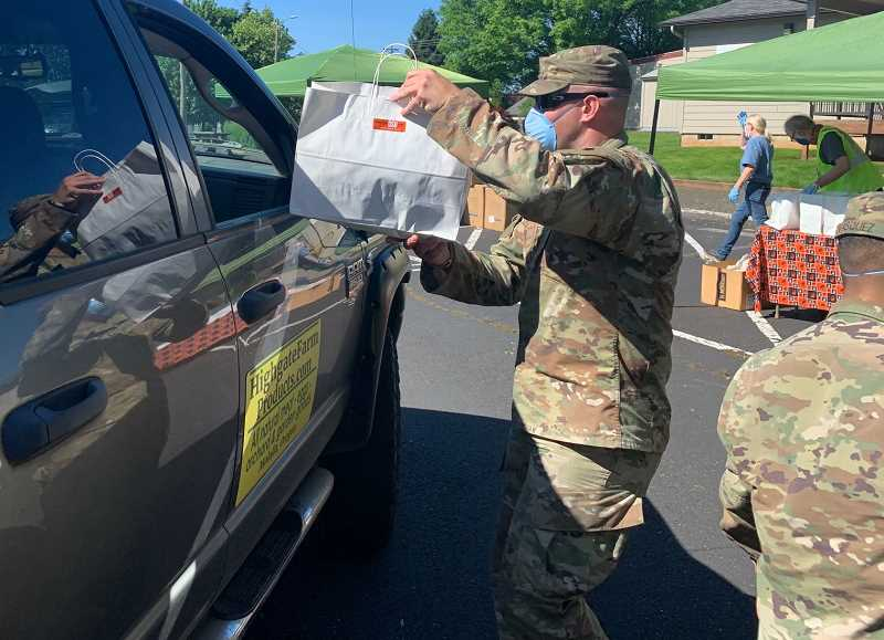 PHOTO COURTESY: KIMBERLY JACOBSEN - Oregon National Guard members distributed masks and hand sanitizer to Clackamas County farmworkers on May 27.